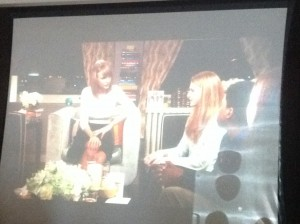 Taylor Swift chats with one of her guests during a Scholastic book talk, Open Possible.