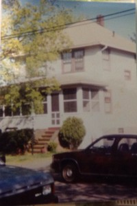 The house I grew up in.  The pine tree is around the other side of the house, but you can see how high the first floor windows are off the ground.